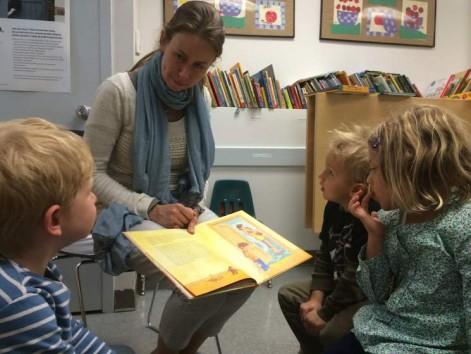 Teacher reading book