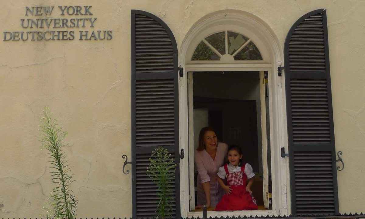 Child and teacher at Deutsches Haus NYU