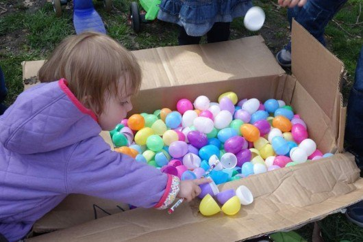 Kid playing with easter egg shells