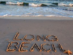 """Long Beach"" written in sand"