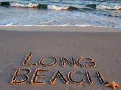 """""""Long Beach"""" written in sand"""
