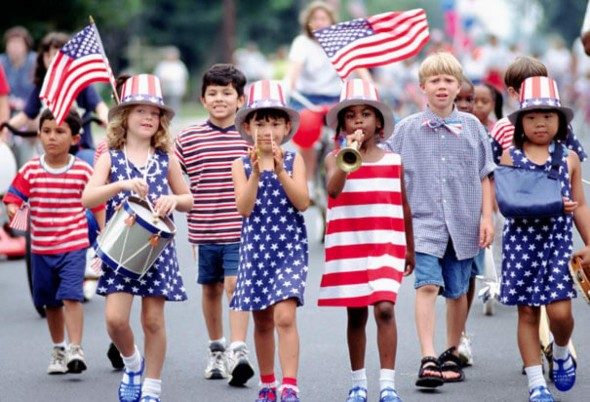 Kids marching in patriotic clothing on July 4 | CityKinder