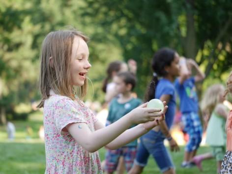 Girl laughing at Summer Picnic 2015 | CityKinder